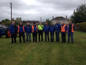 Members of Courtbrack Vintage Society with Garda Sean O'Dwyer