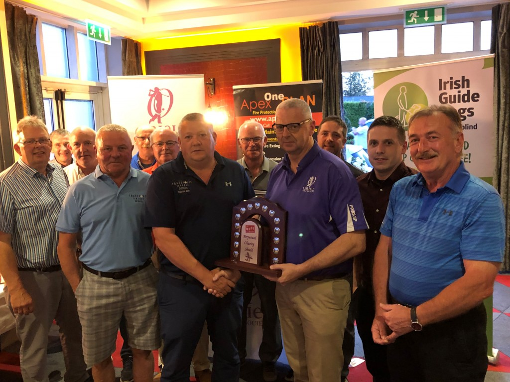 Tom Butler presenting Keith Stafford of Tradehouse Central Golf Society with The Reel Cinema Prepetual Trophy